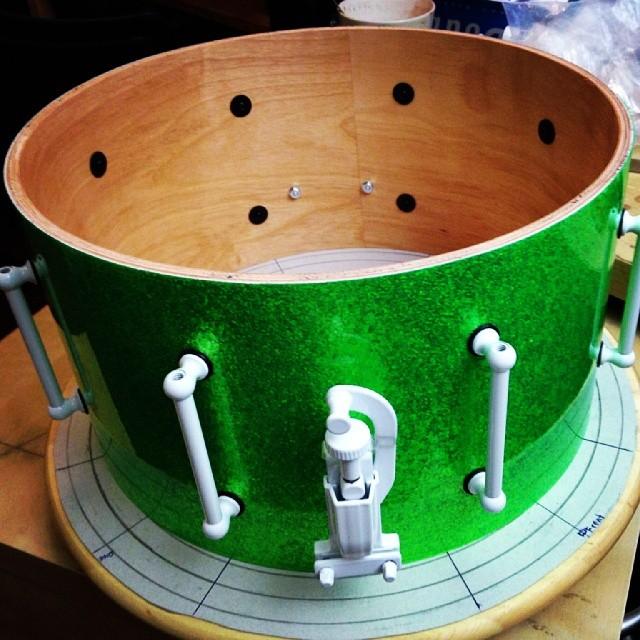 Pantheon Percussion: Lime green sparkle wrap with custom white hardware over 13 x 7 Birch shell for Zai Lim